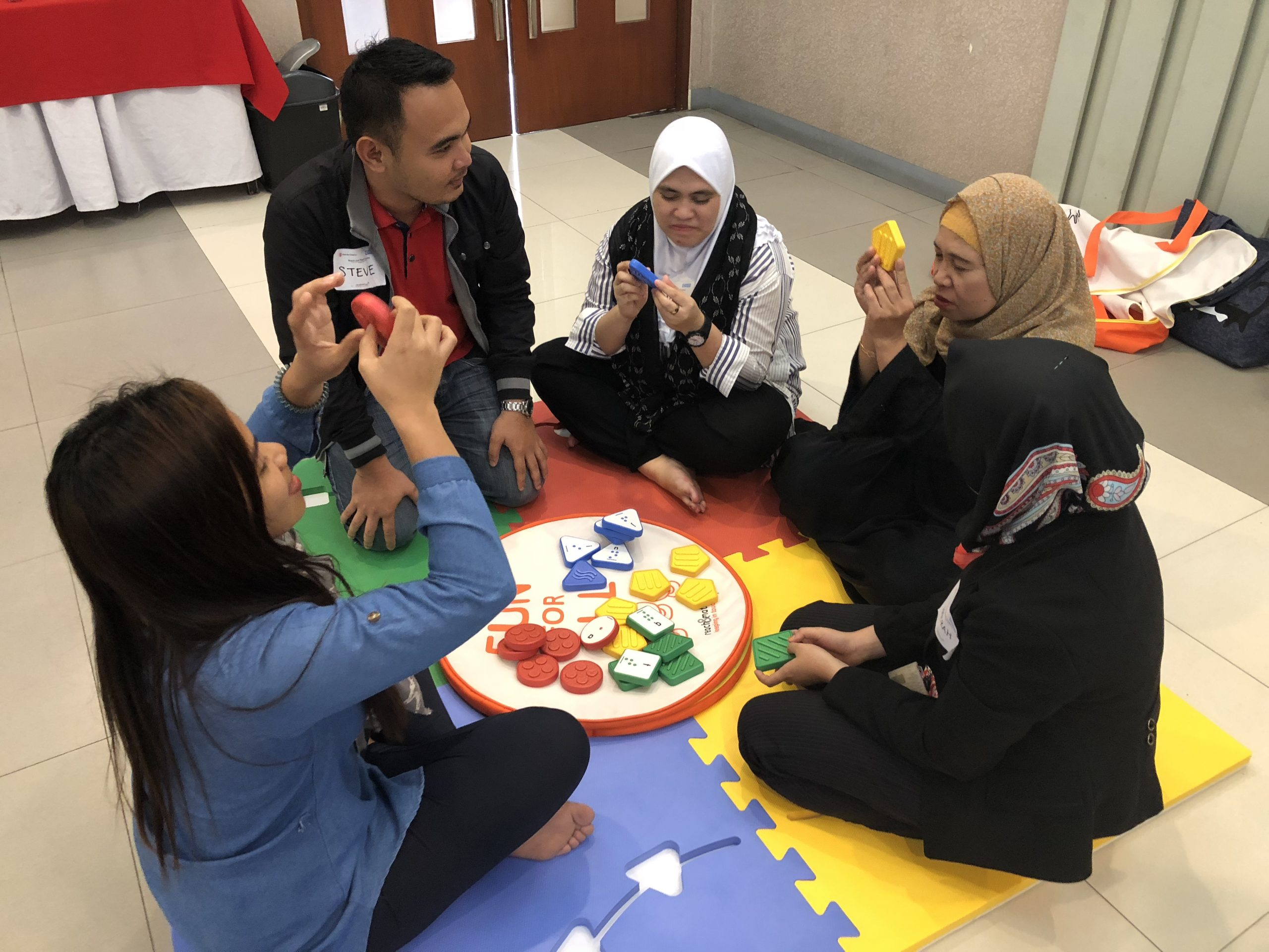 tung wah teachers practice reach and match with children