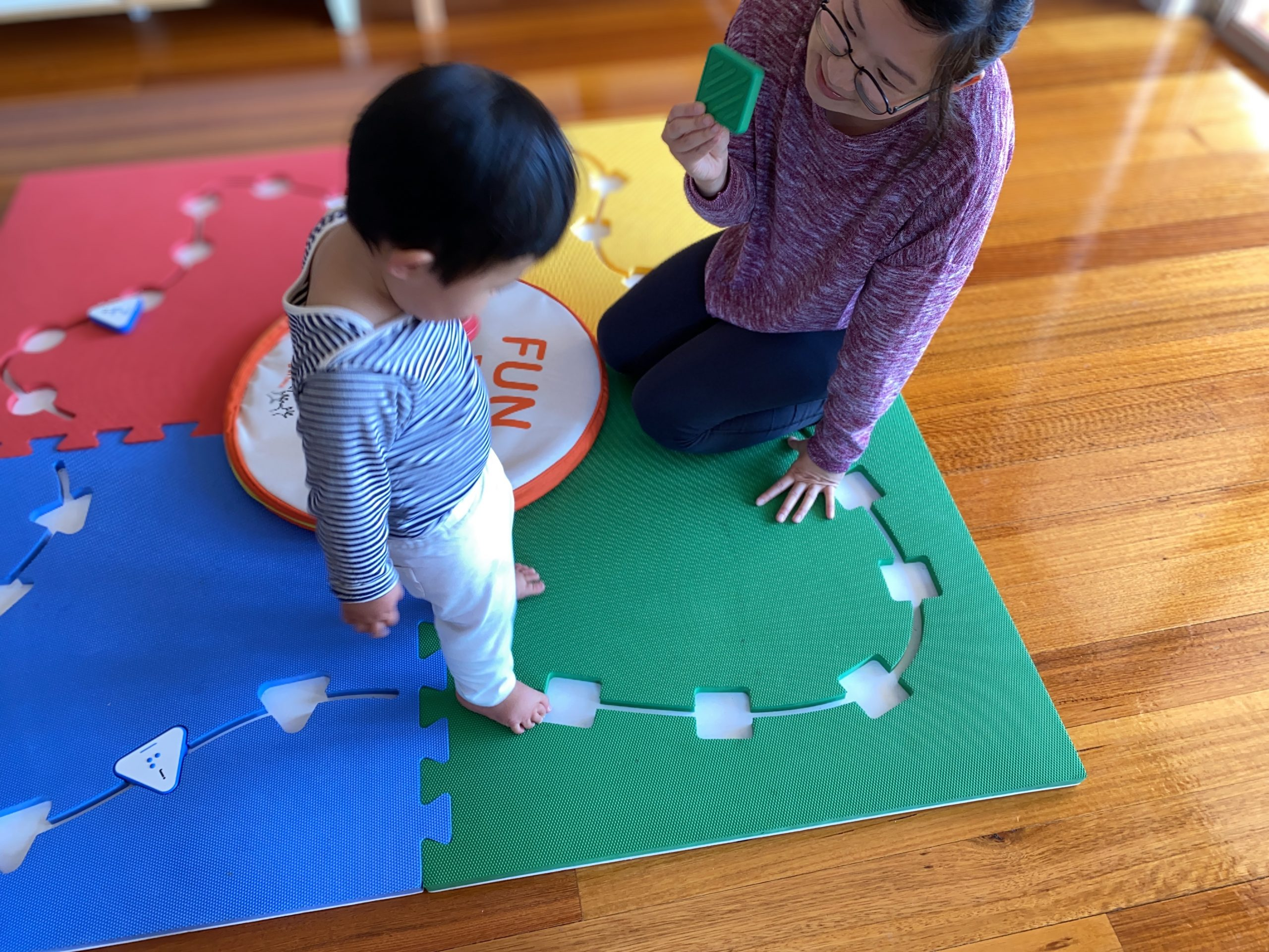 Founder Mandy Lau is playing Reach and Match with her son Oliver at home.