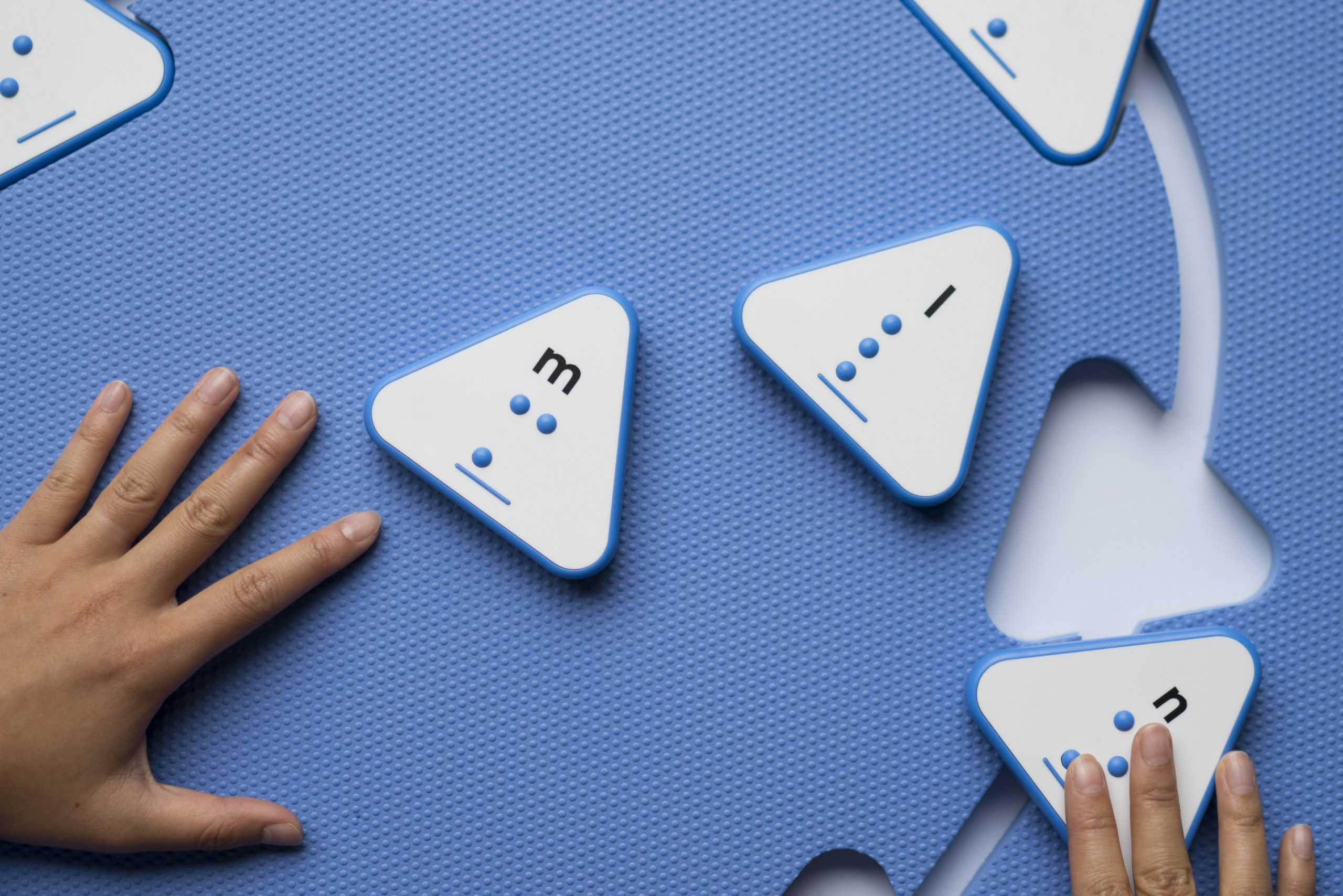 Reach and Match blue mat with braille tiles